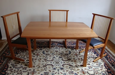Cherry dining table and cantilever chairs