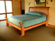 Contemporary Sleigh Bed by Brookside Woodworking.