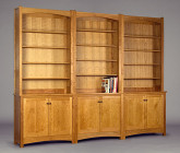 Gloucester three part bookcase. Shown in natural Cherry. Adjustable shelves.