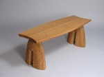Custom outdoor bench in hand carved white oak, by David Hurwitz. Designed and made in Vermont.