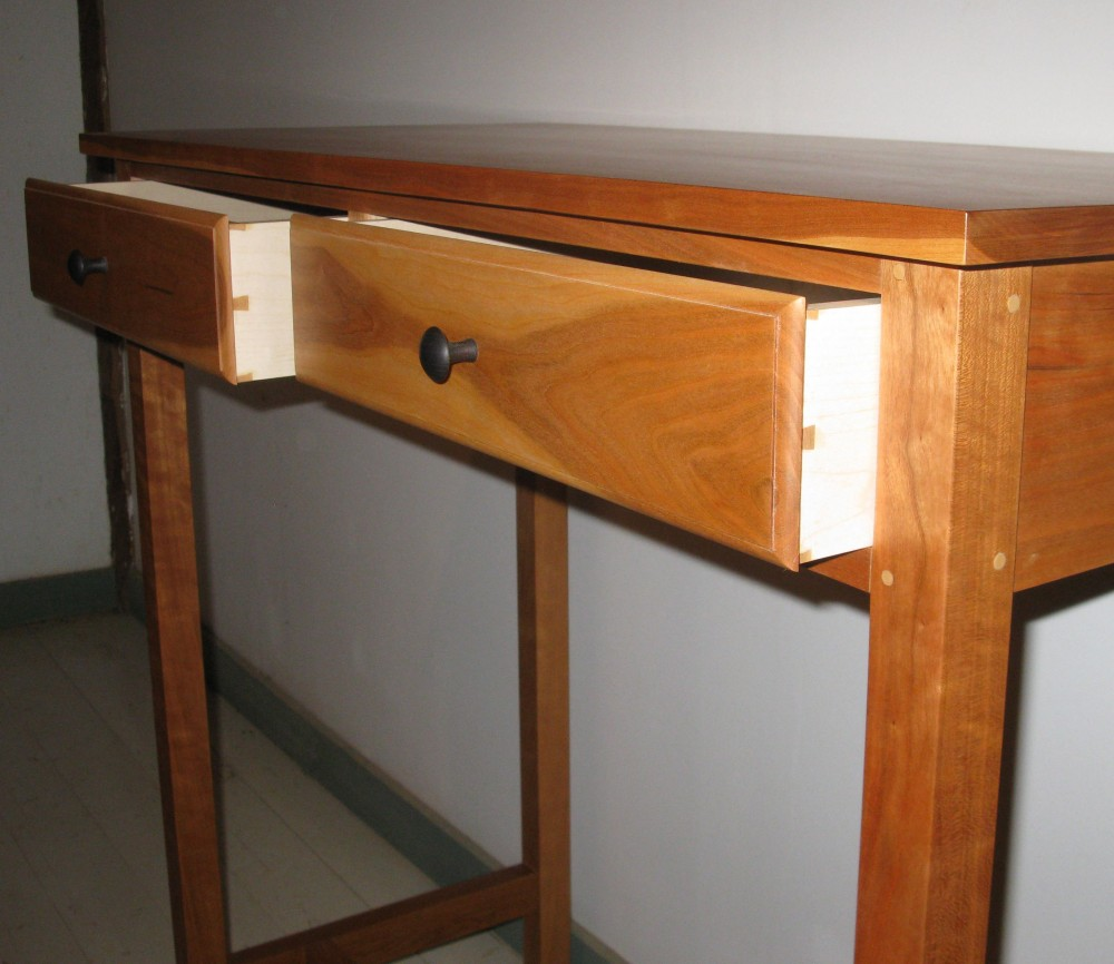 dovetailed drawers with ebonized cherry knobs