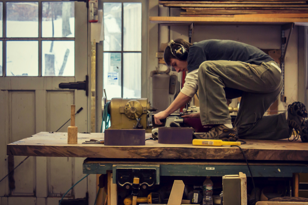Trevor working on a custom slab table