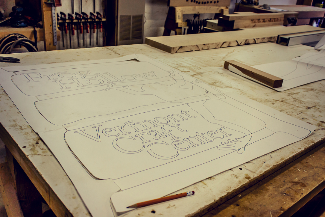 Kit Clark works on a new sign for Frog Hollow State Craft Center