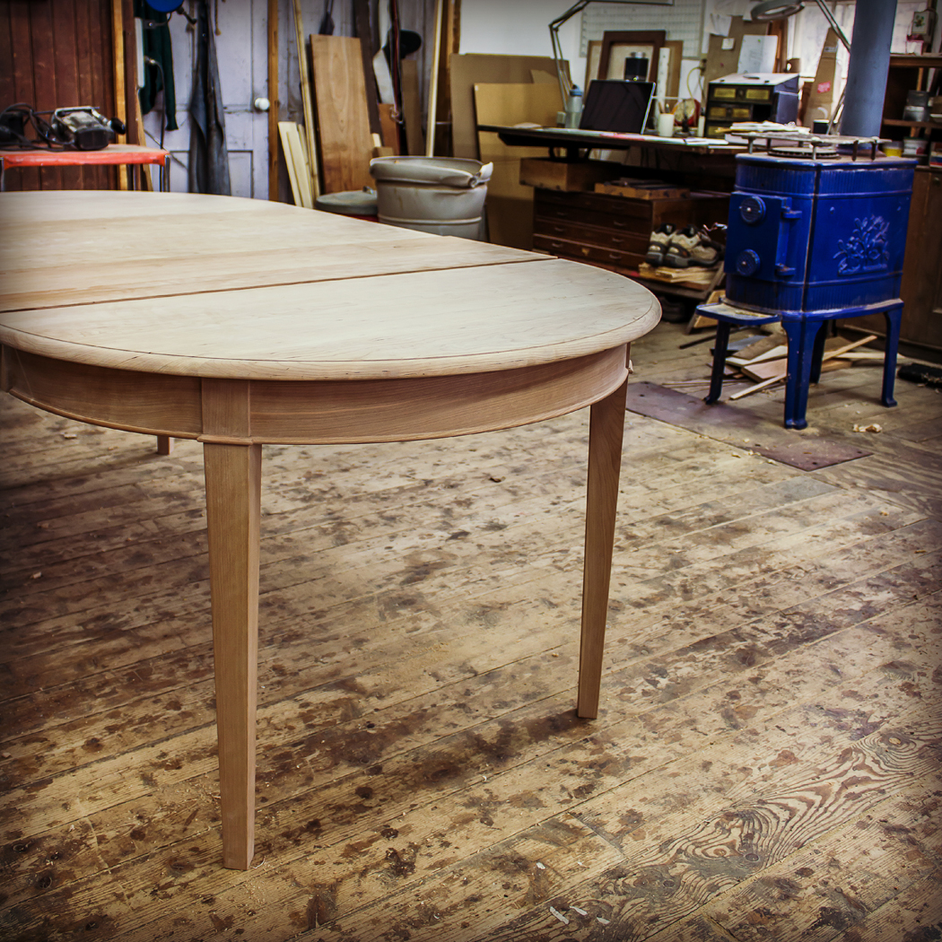 An expandable dining table in process at Metcalf's shop