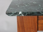 Marble top has a chamfered (45 degree bevel) edge