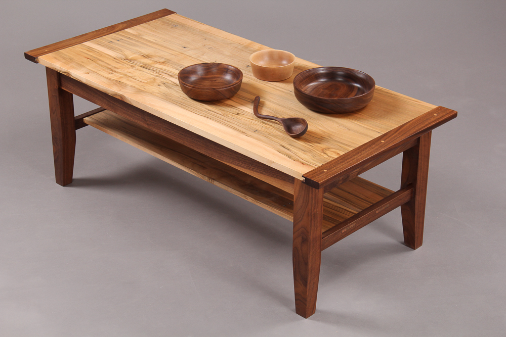 Coffee Table. In Ambrosia Maple and Walnut, with breadboard ends. Small bowls in Maple and Walnut. Hand carved wooden spoon in Walnut.