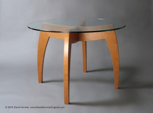 "Small Modern Round Dining Table with 42"" Diameter Glass Top; cherry, 29"" high x 42"" diameter. 1/2"" thick tempered safety glass top with polished edge. By David Hurwitz, Randolph, Vermont. Copyright 2019, David Hurwitz. All rights reserved."